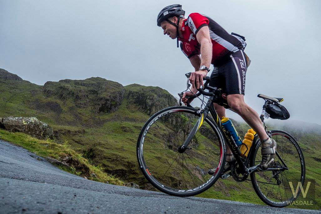 Ian Maddison cycling up Hardknott Pass